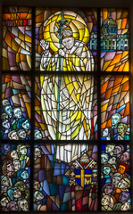 Fototapeta Witraże sakralne Chełm, Poland, 10 September 2018: Stained glass window with the image of Saint Pope John Paul II in the window of the church, the shrine of Our Lady in Chełm