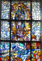 Fototapeta Witraże sakralne Chelm, Poland, 10 September 2018: Stained glass with the image of Mary in the window of the church, the shrine of Our Lady in Chelm