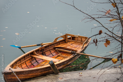 Canvas Print Wooden row boat on a lake