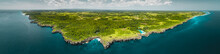 Panorama Island, Ocean. Aerial Drone Shot. Indonesia. Spectacular Overview Of Sumba Island The Green-capped Plain Surrounded By The Indian Ocean On The Blue Cloudy Sky Background.