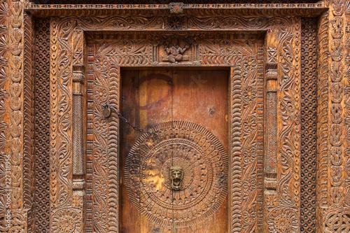 Wall Murals Nepal Traditional wooden carving on the door of building in Vashisht village in Kullu valley, Himachal Pradesh, India