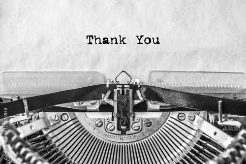 thank you, the text is typed on a vintage typewriter, in black ink on old paper. close-up
