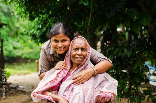 Fotografie, Obraz Young Woman helping Old Woman