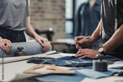 Obraz na plátne  Fashion designer working in his studio
