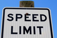 A View Of The Top Of A Speed Limit Sign On A Close View.