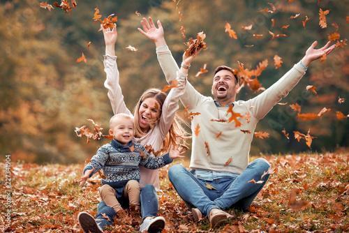 Obraz happy family in autumn park - fototapety do salonu