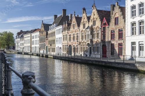 Deurstickers Brugge Sunny cityscape of old historical Belgium town Bruges. Urban landscape photography.