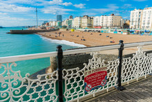 Beautiful View Of Brighton Pier With Brighton Beach Sea, Sand And British Airways I360 In The Background. Popular Landmark Of The City.