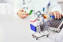 Medicines In Shopping Cart On Desk Of A Drugstore