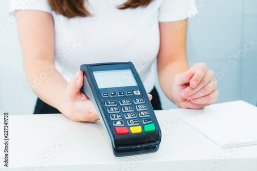 Seller holds payment terminal in hands Canvas Print