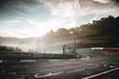 canvas print picture - Die Rennstrecke erwacht im Herbstnebel