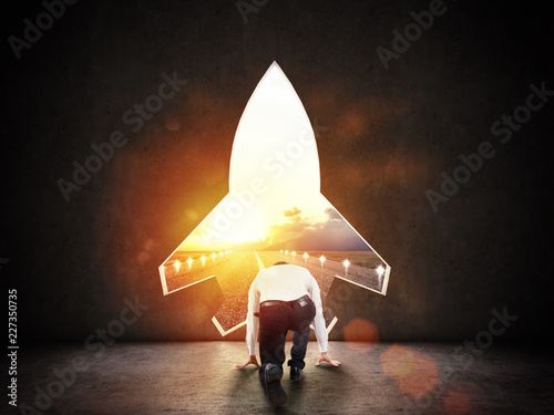 Photo  Concept of startup with a rocket shape hole in the wall which alludes to the dep