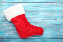 Christmas Stocking On Blue Wooden Table