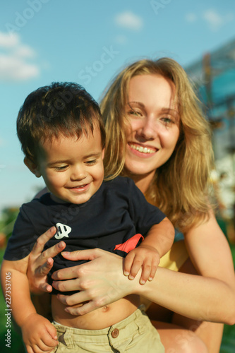 Happy young woman with smiling positive little boy Canvas Print