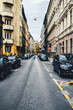 Street with cars and old buildings in the historical district of Budapest city, Hungary