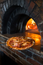 Making Pizza In A Wood Fired O...