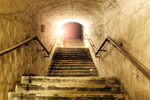 Corridor Of Old Abandoned Underground Soviet Military Bunker. Staircase Goes Up To Surface