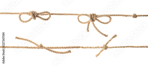 Fototapeta Set with hemp rope, knots and bows on white background