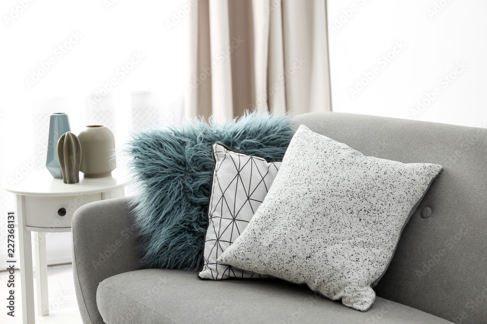 Fototapety, obrazy: Different soft pillows on sofa in room. Interior element