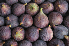 Many Whole Fresh Purple Figs A...