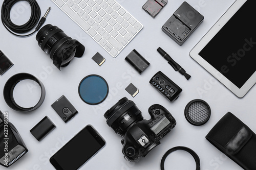 Vászonkép Flat lay composition with equipment for professional photographer on white backg