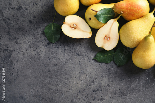 Ripe pears on grey background, top view. Space for text