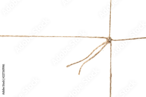 Hemp rope with knot on white background. Organic material Fototapete