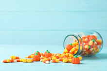 Jar With Delicious Candies On Table Against Wooden Background. Space For Text
