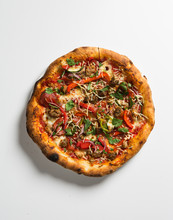 Whole Pizza Over White Surface.