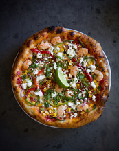 Pizza On A Dish Over A Stained Metal Surface.