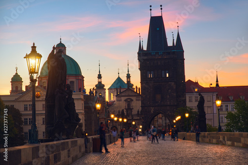 Foto op Aluminium Praag Charles Bridge at dawn: silhouettes of Old Bridge Tower and spires of Old Prague on a sunrise