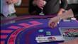dealing at a blackjack table. a fake blackjack table