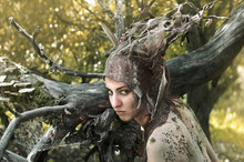 Woman In A Suit Of Felt And Make-up Of Natural Remedies And Forest Debris, The Dryad Hides In An Old Garden Under The Trees