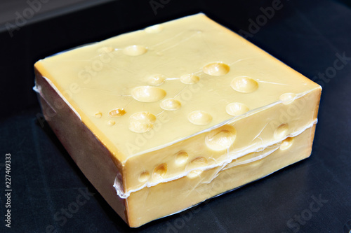 Piece of cheese in vacuum plastic