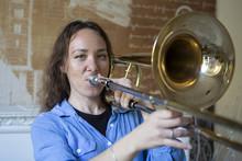 Teenage Girl Playing The Tromb...