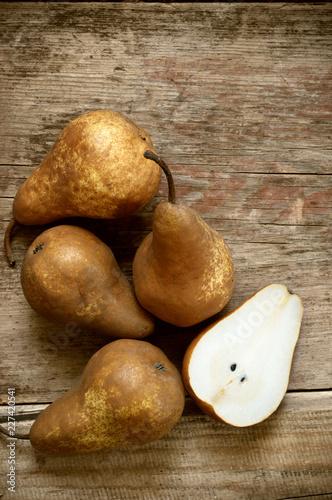 Brown pears on rustic wood