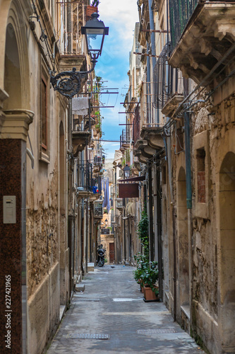 Narrow street Ortigia. Small island which is the historical centre of the city of Syracuse, Sicily. Italy.