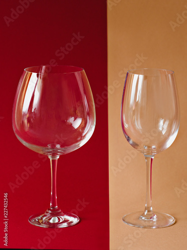 wine glasses on the paper beige and burgundy colors lines background