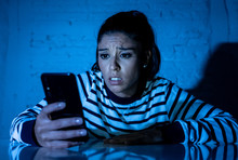 Worried Unhappy Young Woman Suffering From Cyberbullying And Harassment Online By Mobile Phone