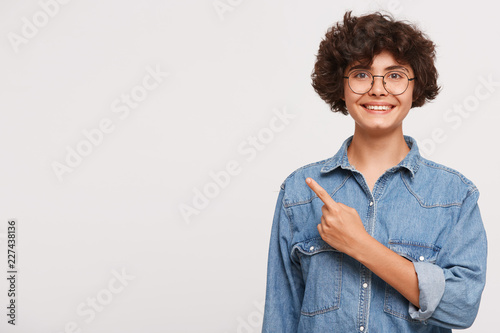d2c1411541 smiling young beautiful girl looks very glad and happy wears oversized  stylish blue denim shirt