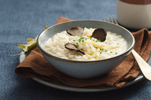 Risotto With Black Truffle And Parmesan Cheese In Blue Plate On Rustic Linen Tablecloth, Copyspace.