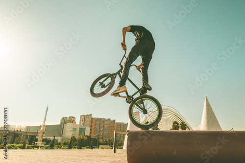 BMX rider doing tricks in the streets