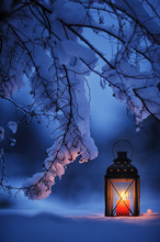 Candle Lantern Under The Snowy...