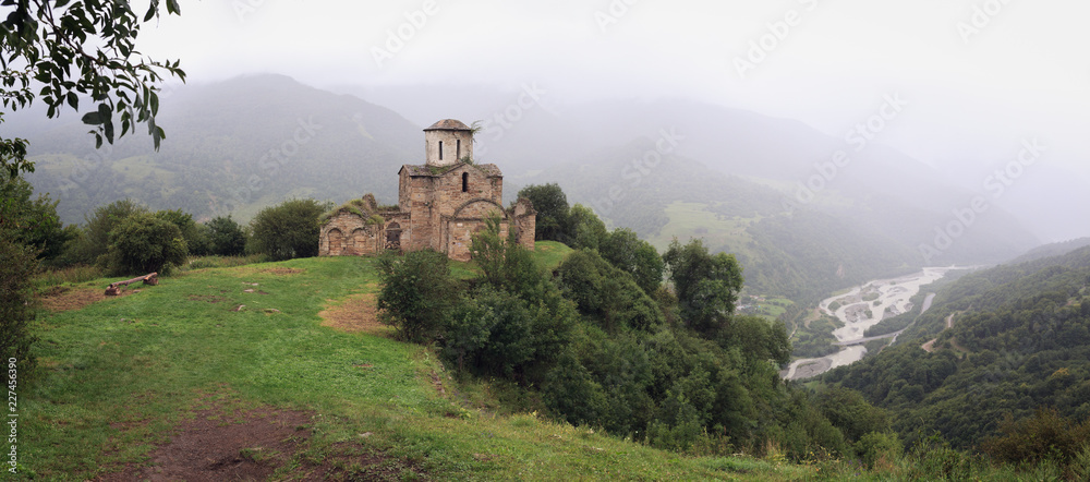 Fototapety, obrazy: Panoramic view of an ancient monastery on top of a mountain in the Caucasus in Russia.