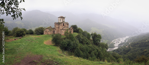 Valokuvatapetti Panoramic view of an ancient monastery on top of a mountain in the Caucasus in Russia