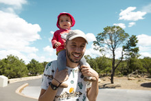 USA, Arizona, Grand Canyon National Park, Father And Baby Girl Carrying On Shoulders