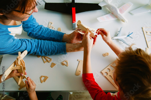 teacher and kids making toy planes, learning concept