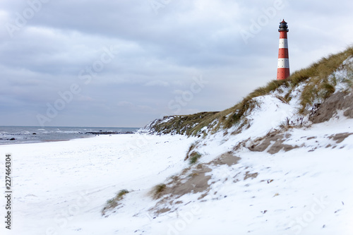 Germany, Schleswig-Holstein, Sylt, beach, dune and lighthouse in winter