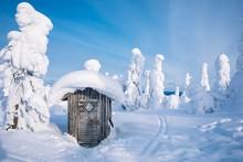 Old Wooden Hut In Winter Snowy...