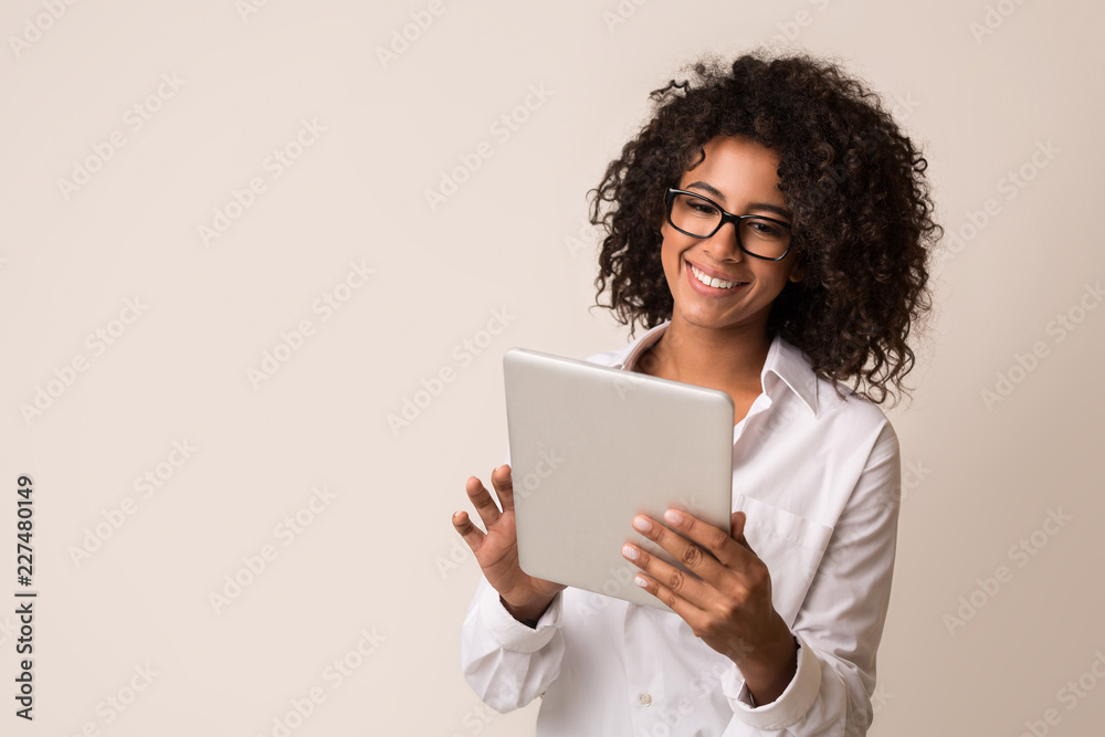 Fototapety, obrazy: Happy businesswoman using tablet over light background